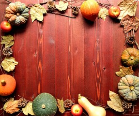 Pumpkins on brown wooden background