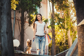 Woman beautiful young happy with long dark hair with small dog