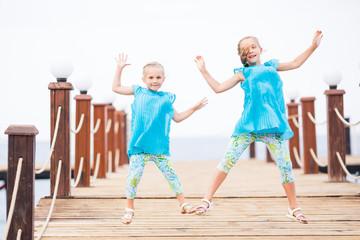 Portrait of beautiful little girls jumping