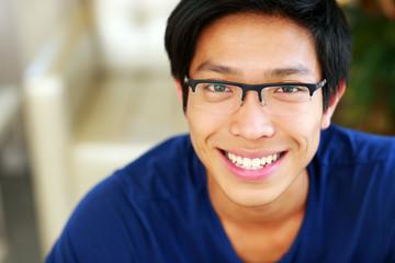 Closeup portrait of a cheerful asian man