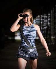 Woman in uniform with binoculars (dark version)