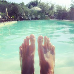Foots in pool water