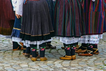 Women wearing traditional bulgarian clothes and shoes