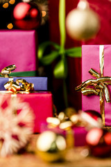 Magenta and Blue Gifts amidst Golden Glitter.