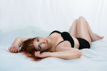 Curvy woman laying in bed