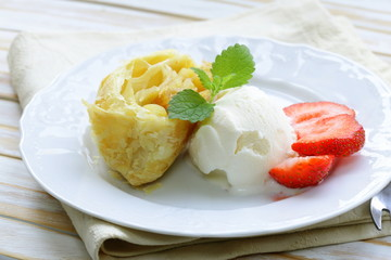 traditional apple strudel with raisins and ice cream