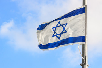Flag of Israel over the sky
