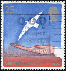 stamp printed in United Kingdom shows a bird in the hand