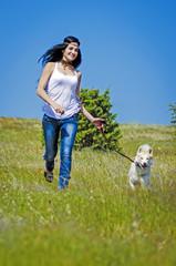 Happy injun woman and white husky running outdoors.Beautiful you