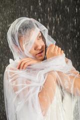girl in white dress lays in water studio
