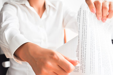 Businesswoman tossing paper