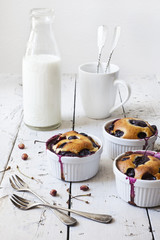 clafoutis with blueberries and cherries with bottle of milk