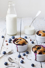 clafoutis with blueberries and cherries with milk bottle