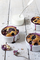french clafoutis with cherries with milk in glass