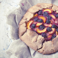 polaroid of whole french galette with sliced fruits
