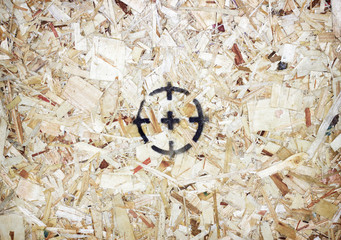 Target on wooden background