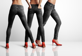 three woman in jeans from back