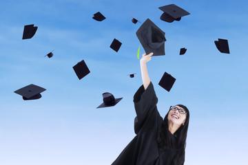 Young bachelor throw graduation cap