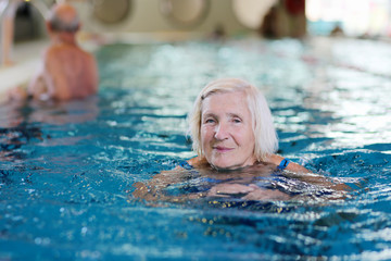 Healthy active senior woman swimming in the pool