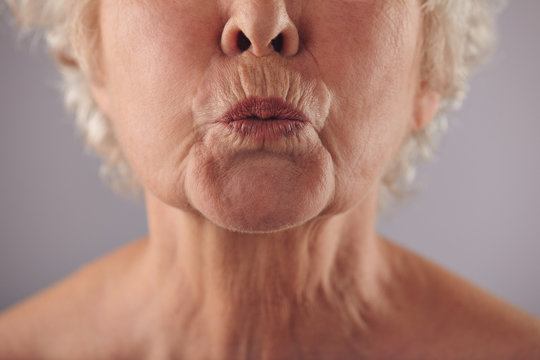 Mature woman puckering lips