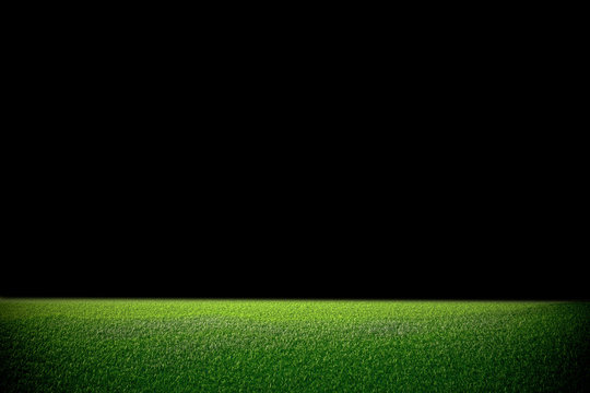 Image of stadium in dark. background green lawn
