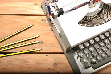 Typewriter and pencils