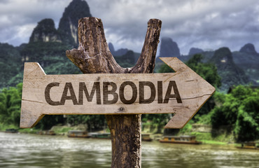 Cambodia wooden sign with a forest background