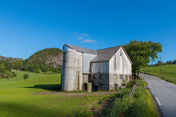 Old farm house and grain silo in Rogaland, Norway