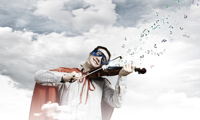 Superman playing violin