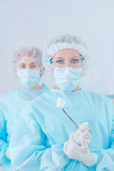 Young beautiful woman doctor in the operating room