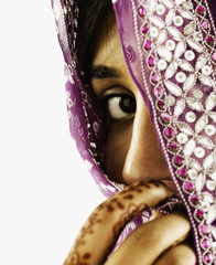 Portrait of woman behind veil