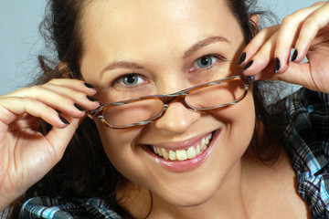 Portrait about smiling woman in glasses
