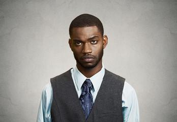 Portrait, headshot Depressed sad man, grey wall background