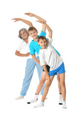 Grandmother exercising with two boys