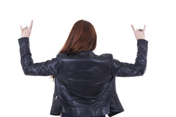 Attractive rocker girl wearing leather jacket and sunglasses