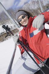 Woman smiling on ski lift