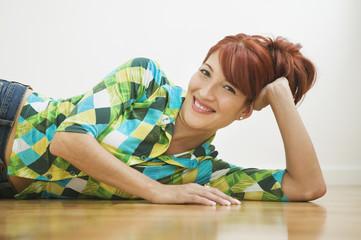 Hispanic woman laying on floor