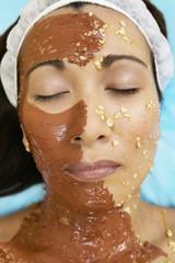 Close up of Asian woman receiving spa facial treatment