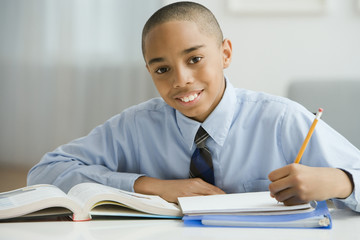 Portrait of African boy studying