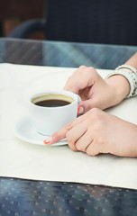 woman drinking coffee at cafe restaurant girl with cup of espres