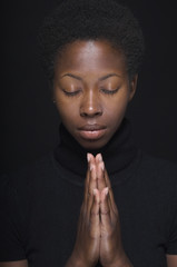Close up of African woman praying