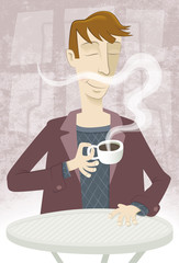 A delicious coffee!. A young man is savoring a cup of coffee