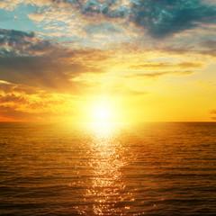 bright orange sunset over sea
