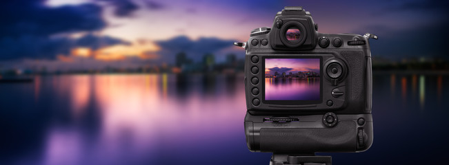 Dslr camera shooting cityscape at sunset
