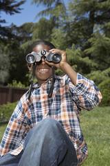 African boy looking through binoculars