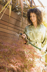 African American woman watering