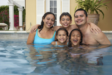 Multi-ethnic family in swimming pool