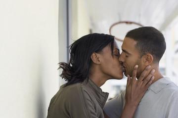 Multi-ethnic couple kissing