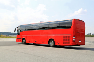 Red Coach Bus Departs on a Journey