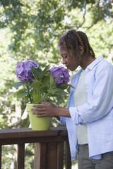 African American woman smelling flowers